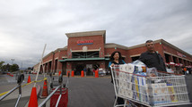 Shoppers push a trolley outside a Costco Wholesale store in Los Angeles