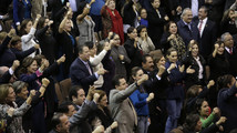 Mexican congressmen celebrate after the lower house gave the final approval to a landmark energy reform in Mexico City