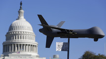 Demonstrators deploy model of U.S. drone aircraft at