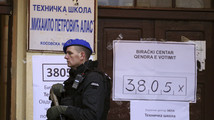A European Union policeman secures a polling station in the northern part of the ethnically-divided town of Mitrovica