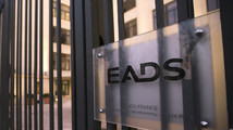 A sign is seen on the entrance gate of the main Paris office building of EADS