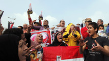 Supporters of Egypt's army chief General Abdel Fattah al-Sisi chant during a rally at Tahrir square in downtown Cairo