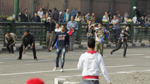 Supporters and opponents of Egypt's army chief General al-Sisi clash during rally in Cairo's Tahrir square