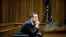 Pistorius vomits in court at Steenkamp autopsy details