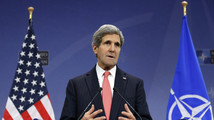 U.S. Secretary of State Kerry addresses a news conference during a NATO foreign ministers meeting in Brussels