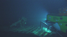 Hawaii Undersea Research Laboratory photo shows a light from a research submarine illuminating the deck of a submerged World War Ii-era Japanese mega-submarine the I-400 discovered off the coast of Oahu
