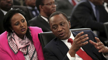 Kenyan President Uhuru Kenyatta chats with his Foreign Minister Amina Mohamed during the two-day meeting of SADC leaders in Pretoria