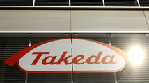 The logo of Japanese Takeda Pharmaceutical Co is seen at an office building in Glattbrugg