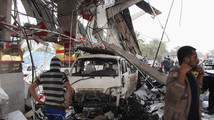 Suicide car bomb, attacks kill at least 42 in Iraq