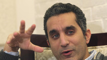 Popular Egyptian satirist Bassem Youssef gestures as he talks during an interview with Reuters in Cairo
