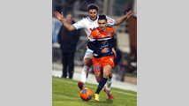 Montpellier's Cabella challenges Olympique Marseille's Gignac during their French Ligue 1 soccer match in Marseille