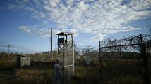 Defense bill gives Obama rare Guantanamo victory