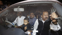 Relatives of Islamist leader Abdul Quader Mollah seated in a vehicle come out of Dhaka Central Jail after meeting him in Dhaka