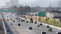 Traffic travels north on the 405 freeway just before the 10 freeway in Los Angeles