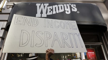Protesters gather outside a Wendy's fast food outlet in support of a nationwide strike and protest at fast food restaurants to raise the minimum hourly wage to $15 in San Diego