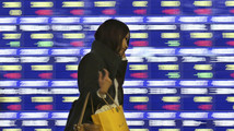 Asian stock markets rise as Fed's decision awaited