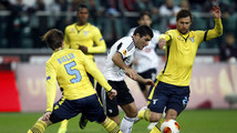 Biglia and Cana of Lazio challenge Brzyski of Legia Warsaw during their Europa League soccer match in Warsaw
