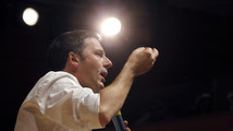 Democratic Party member and Mayor of Florence Renzi gestures as he rallies onstage in Milan