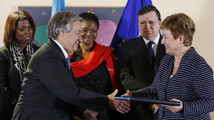 U.N. High Commissioner for Refugees Guterres shakes hands with European Commissioner Georgieva after signing contracts between the European Union and the United Nations on humanitarian support to Syria, in Brussels