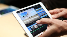 A member of the media holds the new iPad mini with Retnia display during an Apple event in San Francisco