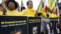 Supporters of Iranian opposition group Mujahadin-e-Khalq rally against Iraq's PM Maliki hours before he is scheduled to meet with U.S. President Obama, outside White House in Washington