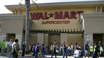 Walmart workers on strike walk a picket line during a protest over unsafe working conditions and poor wages in Pico Rivera