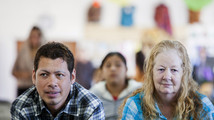 David Amaya and his mother Kathy Amaya listen to a service at Iglesia de Cristo Ministerios Llamada Final in San Diego