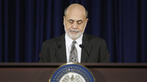 U.S. Federal Reserve Chairman Bernanke pauses during remarks at his final planned news conference before his retirement, at the Federal Reserve Bank headquarters in Washington