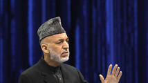 Afghan President Hamid Karzai speaks during the opening of the Loya Jirga, in Kabul