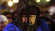 A protester attends an opposition meeting at Independence square in Kiev