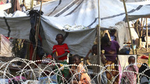 Children are seen in a camp at Mpoko international airport in Bangui