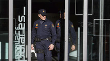 Police officers leave People's Party headquarters in Madrid