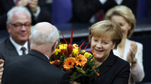 Germany's Merkel starts 3rd term with new allies