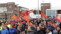 Employees of aircraft company Airbus demonstrate in front of the German headquarter Hamburg-Finkenwerder against planned restructuring measures in Hamburg