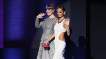 Kelly Osbourne and Nicole Richie walk onstage to present the favorite pop/rock album at the 41st American Music Awards in Los Angeles