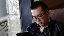 A man use his iPad inside a local coffee shop in downtown Shanghai