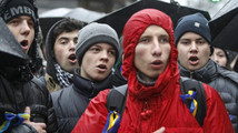 Protesters sing the national anthem during a rally in support of EU integration in Kiev