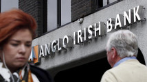 File photograph shows pedestrians walking past a branch of the Anglo Irish Bank in Dublin