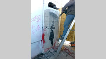 Neighbors foil attempt to steal wall, Banksy mural