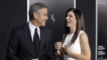 Actors George Clooney and Sandra Bullock arrive for the film premiere of