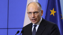 Italian Prime Minister Enrico Letta gestures as he speaks during a news conference at the Prime Minister's Chancellery in Warsaw