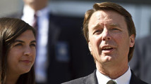 Former U.S. Senator John Edwards makes a statement with his daughter, Cate Edwards after the jury reached a verdict at the federal courthouse in Greensboro
