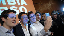 Florence mayor Renzi poses with young supporters during a political meeting in Turin