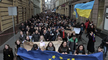 Students hold Ukrainian and European Union flags during a rally to support euro integration in Lviv