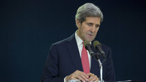 U.S. Secretary of State John Kerry speaks about the death of Nelson Mandela before his departure at Ben Gurion International Airport in Tel Aviv