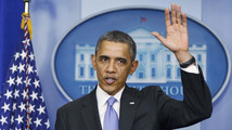 U.S. President Obama gestures waves goodbye at the end of year-end news conference in the White House briefing room in Washington