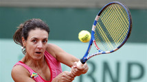 Llagostera Vives of Spain returns the ball to Pavlyuchenkova of Russia during the French Open tennis tournament at the Roland Garros stadium in Paris