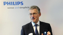 Philips Electronics Chief Executive Frans van Houten shows a LED bulb which can be controlled directly from an iOS or Android device, during the presentation of the 2012 full-year results in Amsterdam