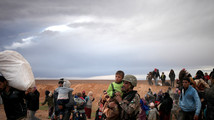 Syrian refugees flee for safety through the desert