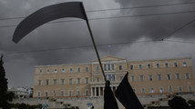 Greek civil servants call strikes over layoffs